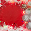 Stock Photo: Christmas lights border with baubles and snow on red background