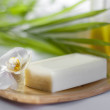 Spa soap and orchid closeup on blurred background — Stockfoto