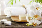 Orchids spa soap and towel concept on wooden boards — Stock Photo