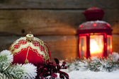 Christmas red bauble and lantern in night on snow with fir — Stock Photo
