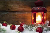Christmas lantern with baubles on snow vintage background — ストック写真