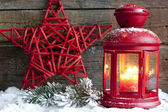 Christmas red star and lantern in night on snow with fir — Stock Photo