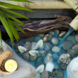 Falling water on stones spa concept background with orchids and bamboo — Stock Photo