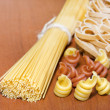 Pasta spaghetti various assortment on table - Stock Photo