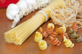 Pasta spaghetti various assortment on table — Foto Stock