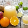 Stock Photo: Fresh fruits juice with squeezer mixed assortment