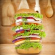 Sandwich very big on vintage wooden boards — Stock Photo #16623107