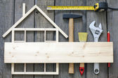 Wooden house construction renovation and tools background — Stock Photo