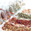 Dried spices in jar on white background closeup — Stock Photo