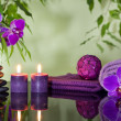Zen stones orchid aromatic candles and towel spa concept — Stock Photo #18154153