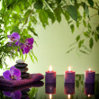 Spa still life with zen stones aromatic candles and orchids — Stock Photo #18154157