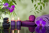 Zen stones orchid aromatic candles and towel spa concept — Stock Photo