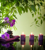 Spa still life with zen stones aromatic candles and orchids — Stock Photo