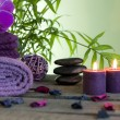 Spa still life with zen stones aromatic candles and orchids — Stock Photo #18246151