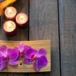 Orchid and candles spa cosmetic abstract vintage background — Stock Photo