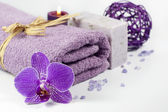 Orchid and towel spa concept with bath salt — Stock Photo