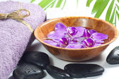 Orchids in the bowl with towel spa cosmetic concept — ストック写真