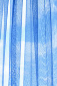 Curtain on window against blue sky abstract background texture — Stock Photo