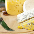 Cheese various assortment on wooden boards — Stock Photo