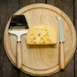Cheese  on wooden boards — Stock Photo