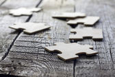 Puzzle on wooden boards team business concept — Stok fotoğraf