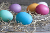 Colorful easter eggs on vintage wooden boards — Stock Photo