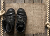 Old military shoes on wooden boards abstract background concept — Stock Photo