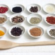 Spices and dried vegetables on vintage white planks - Photo