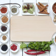 Stock Photo: Spices and dried vegetables with cutting board on white planks