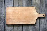 Leere vintage schneidebrett auf planken essen hintergrund konzept — Stockfoto