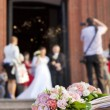 Bride and groom at church background concept — Stock Photo