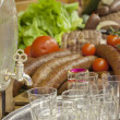 Traditional Polish food on wedding table with sausage and vodka — Stock Photo