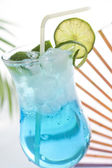 Blue drink cocktail with ice and lemon — Stock Photo
