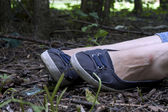 Forensics and investigation girl legs in the forest — Stock Photo