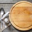 Cutlery and vintage empty cutting board food background concept — Stock Photo #28542697
