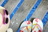 Beachwear on the pier at sea holiday vacation background concept — Stock Photo