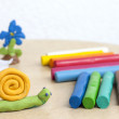 Plasticine on table with snail abstract background concept — Stock Photo