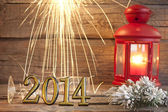 2014 happy new year abstract background sign with sparklers — Stock Photo