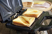 Sandwich toaster with toast closeup — Stock Photo
