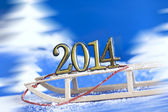 2014 new year numbers on sled abstract on snow background — Stock Photo