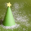 Christmas abstract paper tree on green background — Stock Photo
