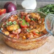 Casserole of chicken in an ovenproof dish with vegetables — Stock Photo
