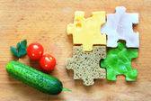 Food puzzle ingredients diet creative abstract concept — Stock Photo