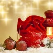 Christmas lantern gifts and baubles on snow abstract background — Stock Photo