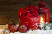 Christmas lantern gifts and baubles on snow abstract background — Photo