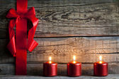 Christmas abstract background with red ribbon on vintage boards — Stockfoto