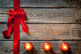 Christmas abstract background with red ribbon on vintage boards — Stock Photo