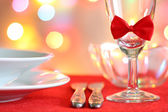 Christmas table abstract background with red ribbon and dishware — Stock Photo