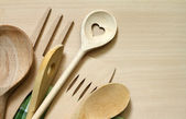Wooden kitchenware on cutting board abstract food background — Stock Photo