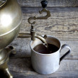 Old retro cup of tea with samovar on vintage table — Stock Photo